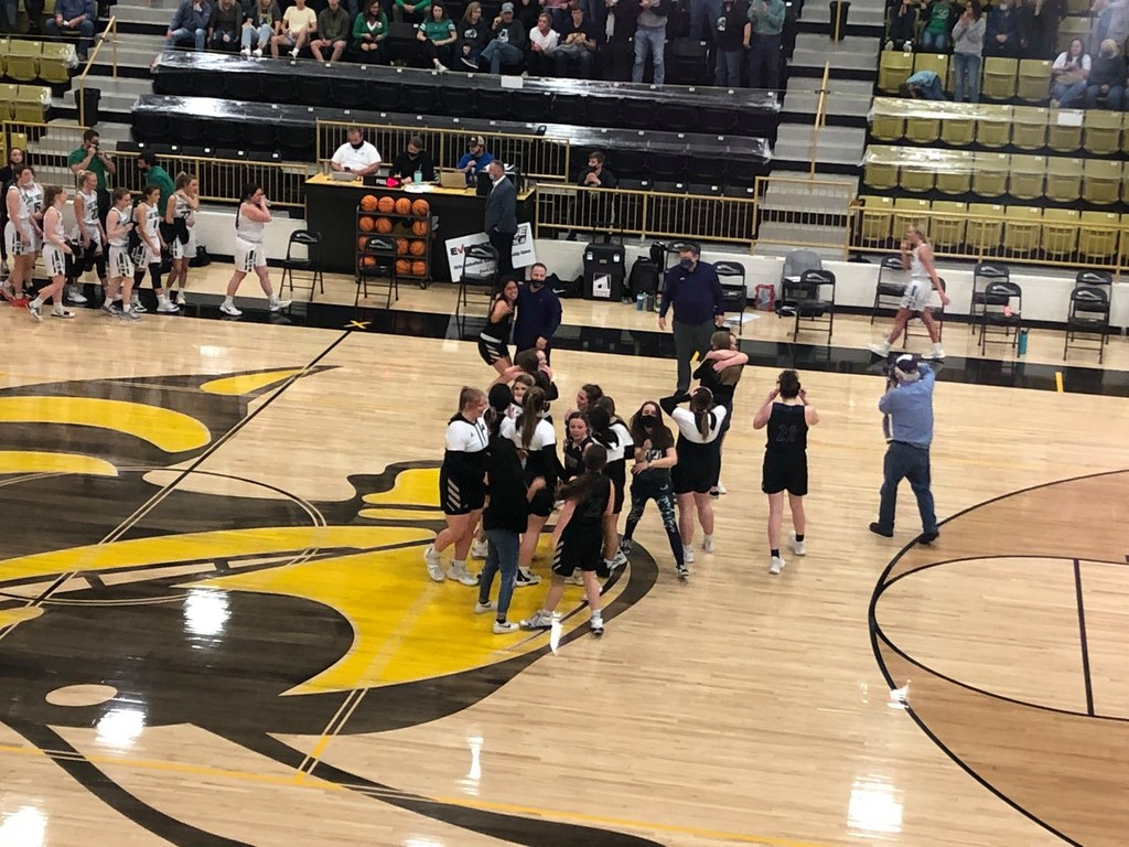 Lady Knights Team Celebrates After Win